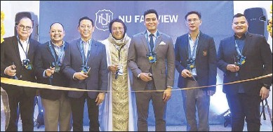 ??  ?? National University opens a new campus at SM City Fairview, the third NU campus to open as part of the university's 10-year expansion program. Quezon City District 5 Rep. Alfred Vargas and District 5 Councilor PM Vargas (right) graced the occasion along with NU board director Ramon Dimacali, NU president RJ Ermita, NU vice chairman of the board Teddy Ocampo, officiating priest Fr. Nonet Legaspi and SM Supermalls COO Steven Tan.
