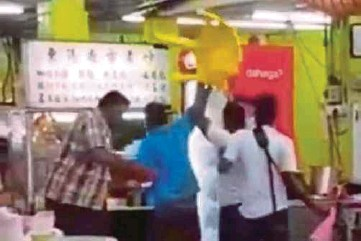 ??  ?? A video grab of the clip that went viral showing men throwing chairs and beer bottles at a restaurant in Stulang Laut in Johor Baru on Saturday.