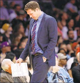 ?? Gary Coronado Los Angeles Times ?? FORMER LAKERS coach Luke Walton, who is now the coach of the Sacramento Kings, has denied the sexual assault allegation brought by Kelli Tennant.