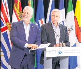 ?? SUBMITTED PHOTO ?? Premier Dwight Ball and Quebec Premier Philippe Coullard were in Edmonton for Council of the Federation meetings Wednesday. They announced an agreement to develop an agreement on border issues around Labrador.