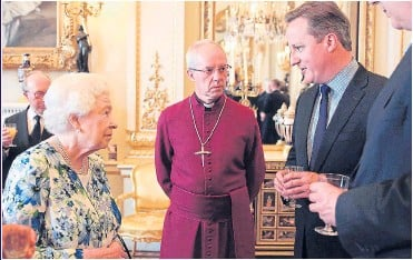 ?? Picture: AFP/GETTY ?? PARTY TALK: Her Majesty with the Archbishop of Canterbury and the Prime Minister