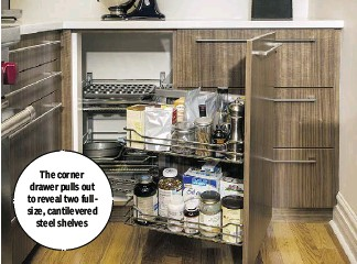 ??  ?? The corner drawer pulls out to reveal two fullsize, cantilevered steel shelves