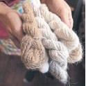 ?? THE NEW YORK TIMES ?? Theresa Furrer, owner of Nine Lives Twine, holds skeins of yarn spun from dog hair.