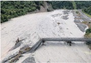 ?? PHOTO: WAYNE COSTELLO ?? Washed out . . . The State Highway 6 bridge over the Waiho River is ripped apart after an ''atmospheric river'' made landfall on the West Coast on March 25, 2019.