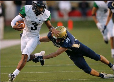 ?? (Arkansas Democrat-Gazette/Thomas Metthe) ?? Little Rock Christian quarterback Justice Hill (3) shoves away Pulaski Academy safety Blake Titus during the Warriors' 52-38 victory in the Class 5A state championship in 2018. The Arkansas Activities Association has put a proposal to a vote that would allow private schools such as Little Rock Christian and PA to move up or down in classification with the aim of creating more balanced competition.