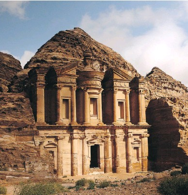 ?? SAM MCNEIL / THE ASSOCIATED PRESS FILES ?? The monastery in Jordan's ancient city of Petra. Technological advances and a willingness by foundations and TV networks to sponsor archeological projects are combining to forge a great age of discovery, Robert Fulford writes.