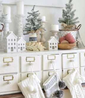 """??  ?? left bottom: STOCKINGS HANG, not by the chimney with care, but on Sarah's vintage card catalog to bring Christmas cheer to her dining room. """"This card catalog is one of my favorite vintage finds, and I got a good deal on it,"""" she says."""