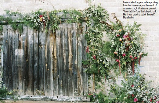 """??  ?? BELIEVE IT OR NOT, these flowers, which appear to be sprouting from the stonework, are the result of an enormous, intricate arrangement. """"I wanted the floral backdrop to look like it was growing out of the wall,"""" Mandi says."""