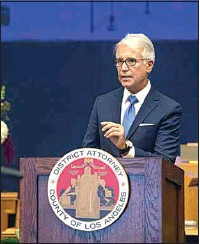 ?? BRYAN CHAN / COUNTY OF LOS ANGELES VIA AP ?? In this photo provided by Los Angeles County, incoming Los Angeles County District Attorney George Gascon speaks after he was sworn in during a mostlyvirtual ceremony in downtown Los Angeles on Dec. 7.