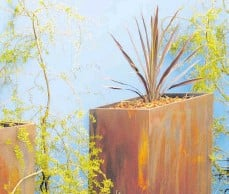 ??  ?? Whether your garden is rustic or contemporary, there's a metal pot to suit.