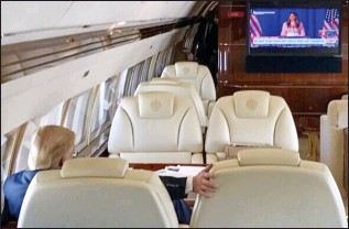 ??  ?? Hair Force One: Donald Trump watches his wife's speech on his private jet