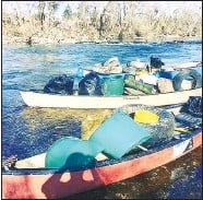 ?? COURTESY PHOTO ?? Loaded canoes — full of trash, tires and other undesirable items — are part of the work the Wagners undertake. Their organization, ICleanWaterways, is dedicated to improving McDonald County waterways by eliminating trash and junk.