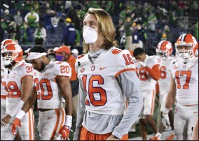 ?? MATT CASHORE - THE ASSOCIATED PRESS ?? FILE - In this Saturday, Nov. 7, 2020file photo, Clemson quarterback Trevor Lawrence (16) leaves the field with his teammates after Clemson lost to Notre Dame 47-40in two overtimes during an NCAA college football game in South Bend, Ind.