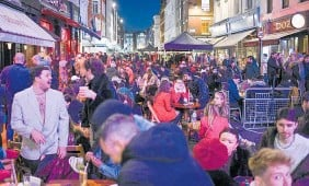 ?? Photo / AP ?? Revellers in London's Soho after restrictions relaxed this week.