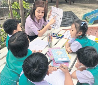 ??  ?? A FOR EF­FORT: In­terkids Bilin­gual School em­ploys 50 Filipino teach­ers. Par­ents like their car­ing 'Thai-style' ap­proach.