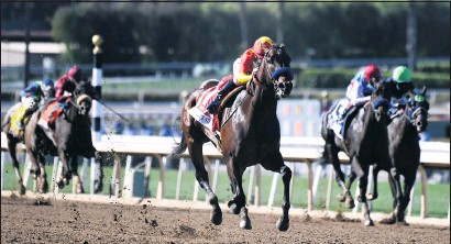 ?? KEITH BIRMINGHAM — STAFF PHOTOGRAPHER ?? Jockey Mike Smith, middle, riding Life is Good, wins the Grade II San Felipe Stakes during a big day of horse racing at Santa Anita Park in Arcadia on Saturday. The win marks Life Is Good as a strong contender for the Kentucky Derby in May.