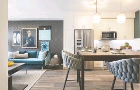 ??  ?? The open concept kitchen and great room offer a welcoming space to gather with friends. The Emerald's well-sized bedroom has plush carpet.