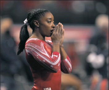 ?? JEFF ROBERSON ?? FILE — Simone Biles prepares for the floor exercise during the women's U.S. Olympic Gymnastics Trials in St. Louis, in this Sunday, June 27, 2021, file photo. Biles, the reigning world and Olympic champion, believes the culture within USA Gymnastics is more relaxed now than it was under former national team coordinator Martha Karolyi, maybe too relaxed. (AP Photo/Jeff Roberson, File)
