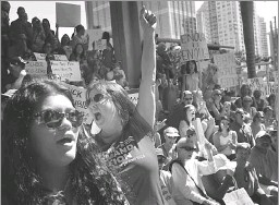 ?? Brynn Anderson/The Associated Press ?? Helena Moreno (center) was among thousands who rallied Saturday in Fort Lauderdale, Fla., to demand that immediate action be taken on gun-control legislation.