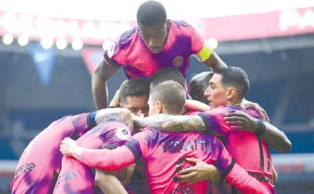 ?? - AFP photo ?? Paris Saint-Germain's Argentinian forward Mauro Icardi celebrates with teammates after scoring a goal during the French L1 football match between Paris-Saint Germain and Saint-Etienne on Sunday.