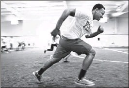 ?? PHOTOS BY KYLE KURLICK/SPECIAL TO THE COMMERCIAL APPEAL ?? Tavis Conner, a junior at Northside, runs through sprinting drills during the combine. About 80 players participated in the event.