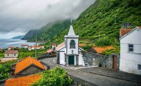 ??  ?? Left: misty Atlantic sunrise over the Azores. Below: small church and settlement on the island of Santo Antão