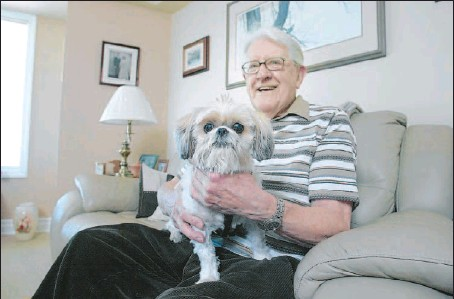 ?? PHOTOS BY PAT MCGRATH, THE OTTAWA CITIZEN ?? George Topping and Lady, were the very first residents to move into Brockville's newest retirement residence, the Wedgewood, which sits by the St, Lawrence River. The widower still drives his own car and takes Lady for walks several times a day. He...