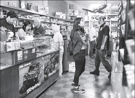 ?? Photographs by Dania Maxwell Los Angeles Times ?? SOME LONGTIME Evett's customers are launching a GoFundMe campaign to raise $50,000 to allow the store to relocate and stay open.