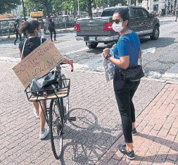 """?? INES BEL AIBA AFP VIA GETTY IMAGES FILE PHOTO ?? A protester in Washington this month had a sign reading """"South Asians for Black Lives"""" on the back of her bicycle. The reckoning of anti-Blackness steeped in the very pores of our existence has become urgent, Shree Paradkar writes."""