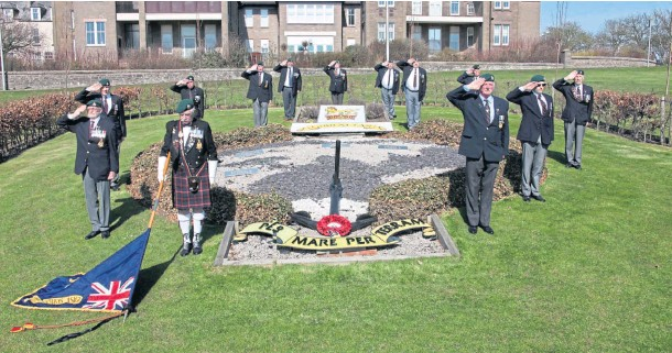 ??  ?? LAST RESPECTS: Members of East of Scotland Royal Marines Association laid a wreath and held a 15-minute silence in memory of Prince Philip.