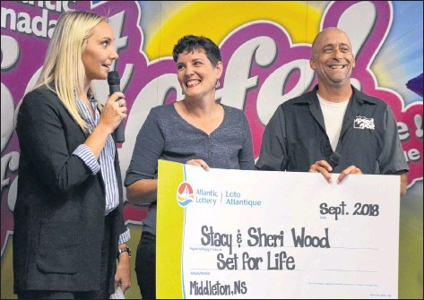 ?? LAWRENCE POWELL ?? Sheri and Stacy Wood were handed a cheque for $675,000 in a ceremony at the PSP Community Recreation Centre in Greenwood Sept. 27. They won Atlantic Lottery's Set for Life and opted for a lump sum instead of $1,000 a week for 25 years. They're seen here with Atlantic Lottery's Abby MacDonald.