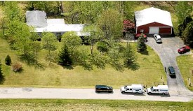 ?? AP ?? AERIAL photo shows one of four locations being investigated in Pike County, Ohio, where seven adult members of a family and a teenage boy were killed.