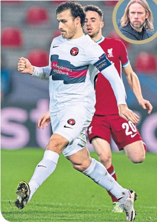 ??  ?? Midtjylland's Erik Sviatchenko, seen in action against Liverpool in the Champions League, is enjoying working with Austin MacPhee (inset)