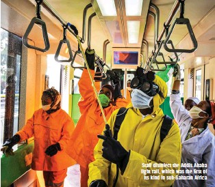 ??  ?? Staff disinfect the Addis Ababa light rail, which was the first of its kind in sub-saharan Africa