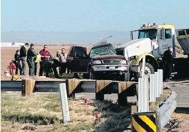 ?? KYMA VIA THE ASSOCIATED PRESS ?? Police and rescue personnel work at the scene of a deadly crash involving a semitruck and an SUV in Holtville, California, on Tuesday.