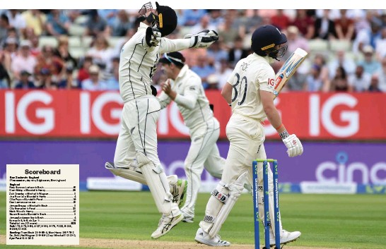 ?? Photo / AP ?? New Zealand wicketkeeper Tom Blundell (left) celebrates the dismissal of England's Ollie Pope (right, walking off the wicket) at Edgbaston.