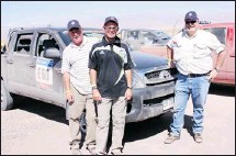 ?? Howard J. Elmer, Postmedia News ?? Writer Howard J. Elmer, right, with Volkswagen navigators Walter and Willy at the Dakar Rally. Elmer was a guest of Volkswagen at the rally.