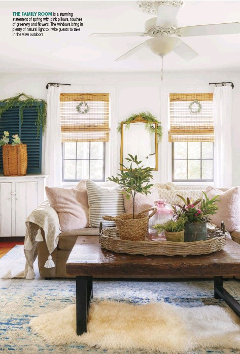 ??  ?? THE FAMILY ROOM is a stunning statement of spring with pink pillows, touches of greenery and flowers. The windows bring in plenty of natural light to invite guests to take in the view outdoors.