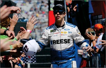 ?? AP PHOTO BY STEVE HELBER ?? In this March 24, 2019 file photo, NASCAR Cup Series driver Brad Keselowski greets fans during driver introductions prior to the NASCAR Cup Series auto race at the Martinsville Speedway in Martinsville, Va. Keselowski didn't get the finish he hoped for last weekend of April 4, when NASCAR'S Cup Series ran on the dirt at Bristol Motor Speedway, but the 2012 champion didn't dwell too long on his 11th place finish.