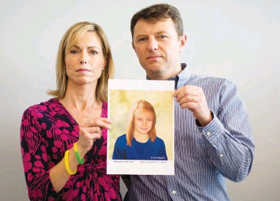 ?? Picture: AFP ?? STOLEN YEARS. Parents of missing girl Madeleine McCann, Kate and Gerry, pose with an artist's impression of how their daughter might have looked at age nine. She turned 18 yesterday.