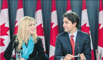 ?? JUSTIN TANG /THE CANADIAN PRESS ?? Eve Adams was joined by Liberal Leader Justin Trudeau as she announced in Ottawa that she was leaving the Conservative Party to join the Liberal Party of Canada. Her fiancé, who is also a former Conservative, has thrown his support behind her campaign.