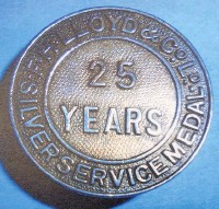 ??  ?? A badge for 25 years' service