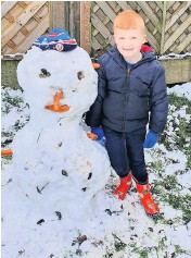 ??  ?? ●● Rory Kershaw, 5, standing next to his snowman