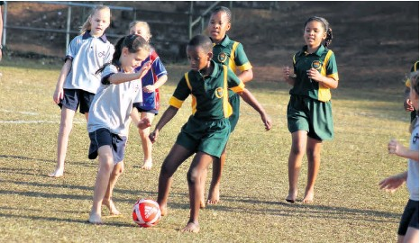 ??  ?? Grantham Park's Xoliswa Mabaso is challenged by Richards Bay Christian School's Kacey Hughes in their match-up