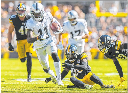 ?? Benjamin Hager Las Vegas Review-journal @benjaminhphoto ?? Raiders wide receiver Henry Ruggs III breaks away from Steelers defenders during the Raiders' 26-17 victory in Pittsburgh on Sunday. The win moves the Raiders to 2-0 as they head home to face the Miami Dolphins next weekend. ▶