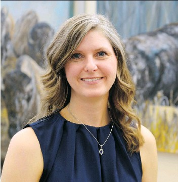 """?? MICHAEL BELL ?? Carleen Ross stands in front of her exhibition """"From Sea to Sea"""" at the RCMP Heritage Centre. The series of paintings features bison, an animal that has strong ties to the RCMP."""