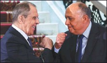 ?? RUSSIAN FOREIGN MINISTRY VIA ASSOCIATED PRESS ?? Russian Foreign Minister Sergei Lavrov (left) and Egyptian Foreign Minister Sameh Shukry greet each other after a joint news conference in Cairo on Monday.