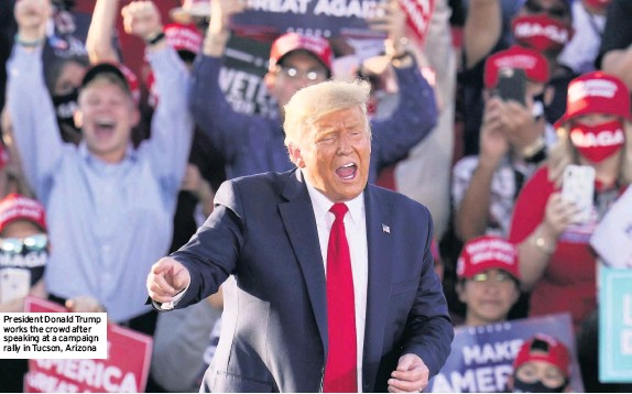 ??  ?? President Donald Trump works the crowd after speaking at a campaign rally in Tucson, Arizona
