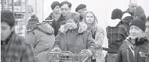 ?? WAYNE CUDDINGTON /OTTAWA CITIZEN ?? Customers line up at the cash as shoppers look for Boxing Day bargains at Best Buy on Merivale Road on Wednesday.