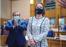 ?? EDDIE MOORE/JOURNAL ?? Sen. Benny Shendo Jr., D-Jemez Pueblo, left, and others applaud Sen. Mimi Stewart, D-Albuquerque, after she was sworn in Tuesday as the Senate's new president pro tem.
